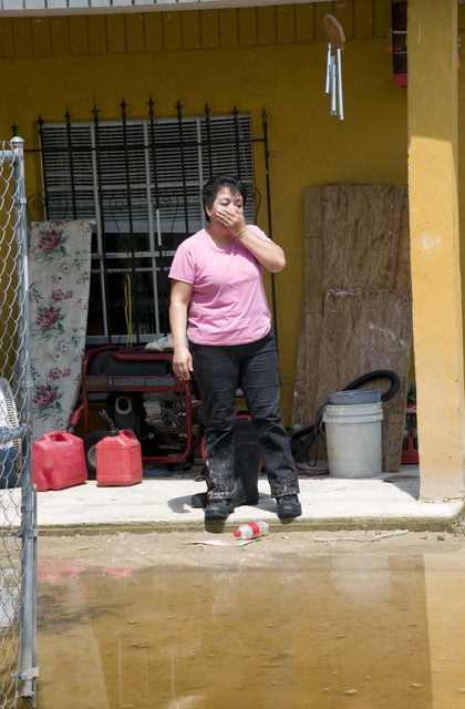 [Hurricane Dolly] Edinburg, TX, July 31, 2008 -- A resident in Edinburg shows her frustration at her living situation.  Her house was flooded during Hurricane Dolly and she is still dealing with residual flooding.  South Texas is still recovering from Hurricane Dolly, with many towns flooded and the residents are still without power or water.  Photo by Patsy Lynch/FEMA