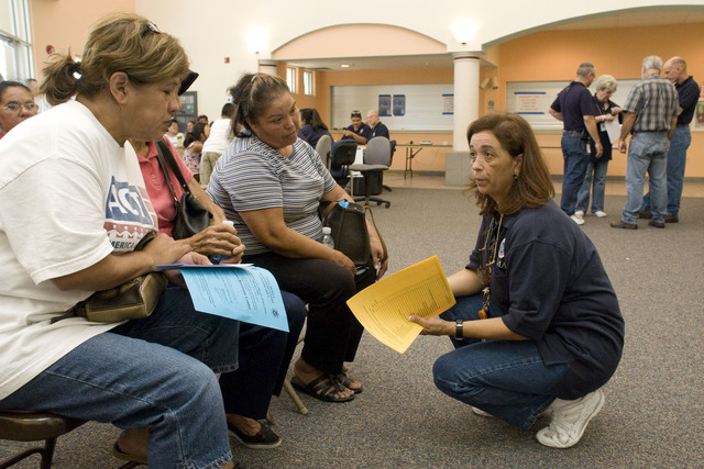 [Hurricane Dolly] Harlingen, TX, August 3, 2008 -- A FEMA employee talks to residents in the DRC in Harlingen, TX DRC who are applying for assistance after their homes were damaged during Hurricane Dolly.  Photo by Patsy Lynch/FEMA