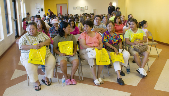 [Hurricane Dolly] Brownsville,TX, August 7, 2008 -- Residents of Brownsville, TX attend a town hall meeting.  The meeting was conducted by representatives from FEMA for Spanish speaking residents.  Photo by Patsy Lynch/FEMA