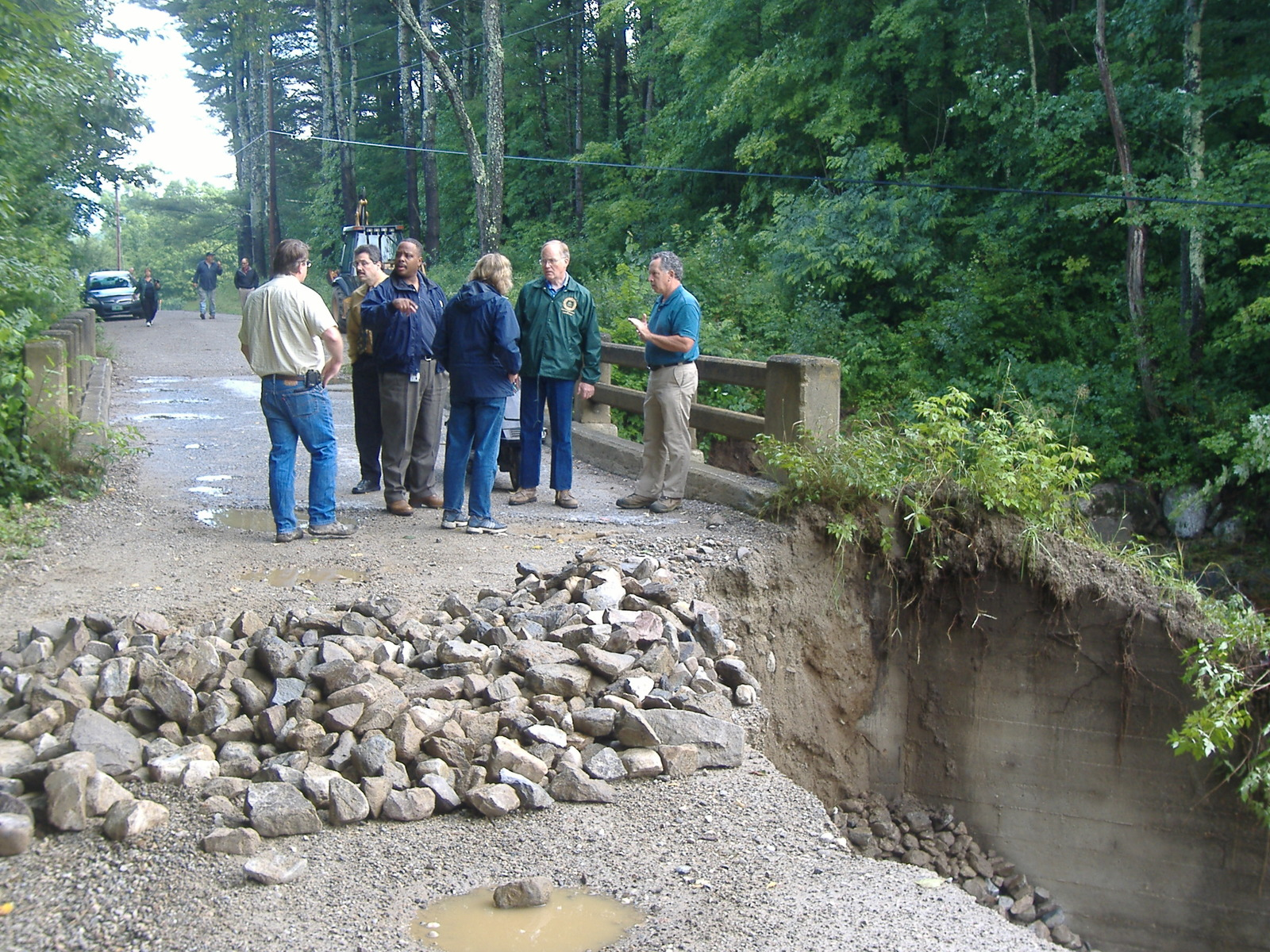 Ripton, Vermont, August 7, 2008 -- Vermont Governor Jim Douglas and FEMA FCO Phil Parr join local officials in surveying a damaged bridge.  Several days of heavy rains caused flash flooding in much of Central Vermont.  FEMA Photo/Brian Hvinden