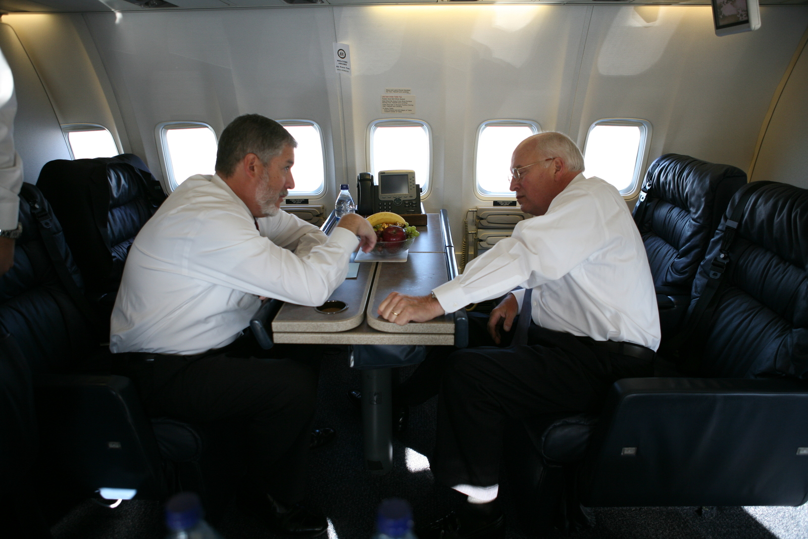 Vice President Cheney Talks with David Addington Aboard Air Force Two En Route to Creech Air Force Base