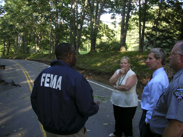 [Severe Storms, Tornado, and Flooding] New Hampton, NH, August 13, 2008 -- FEMA FCO Phil Parr and NH Governor Lynch also toured damages in the town of New Hampton where PDA teams had been inspecting damages to public infrastructure in Belknap and Grafton counties.  Heavy rains and flash flooding forced the closure of multiple roads and bridges in the region.  Darby Duffin/FEMA