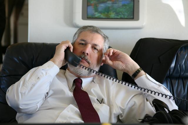 David Addington Talks on Telephone While Aboard Air Force Two
