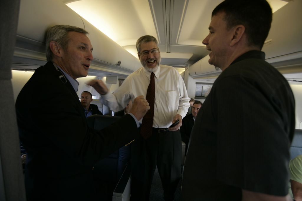 David Addington Talks with Secret Service Special Agent in Charge Dale Pupillo and Military Aide Lt. Col. Dan Simpson Aboard Air Force Two En Route to Washington, D.C.
