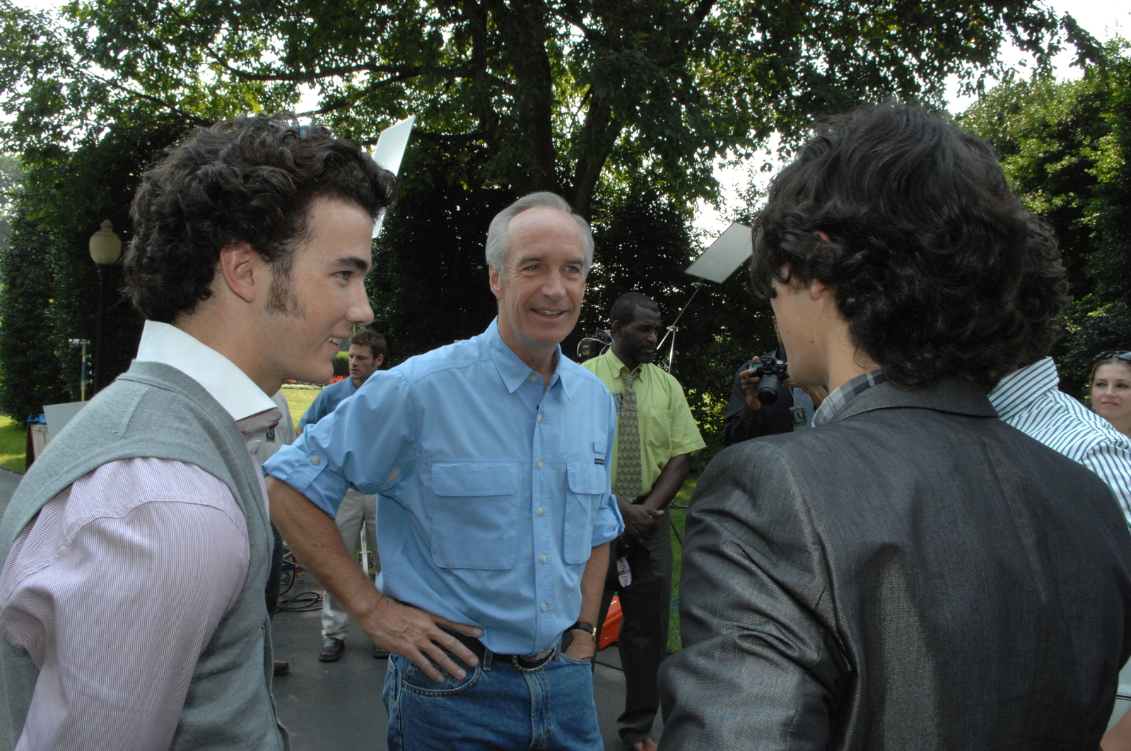 "[Assignment: 48-DPA-08-18-08_SOI_K_Jonas_Bros] Secretary Dirk Kempthorne [and aides joined by pop music stars], the Jonas Brothers--Kevin, Joe, and Nick--for work on Public Service Announcement (PSA) [video, shot on the White House South Lawn, promoting the ""Get Outdoors, It's Yours"" campaign] [48-DPA-08-18-08_SOI_K_Jonas_Bros_IOD_3085.JPG]"