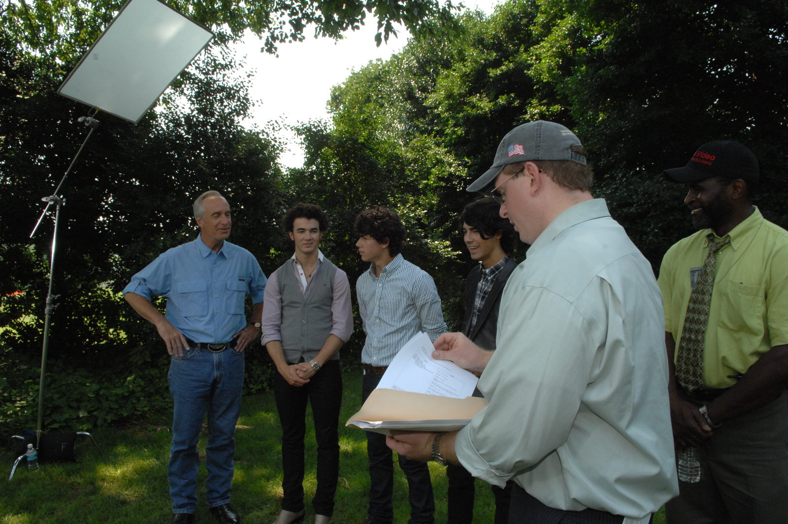 """[Assignment: 48-DPA-08-18-08_SOI_K_Jonas_Bros] Secretary Dirk Kempthorne [and aides joined by pop music stars], the Jonas Brothers--Kevin, Joe, and Nick--for work on Public Service Announcement (PSA) [video, shot on the White House South Lawn, promoting the """"Get Outdoors, It's Yours"""" campaign] [48-DPA-08-18-08_SOI_K_Jonas_Bros_IOD_3108.JPG]"""