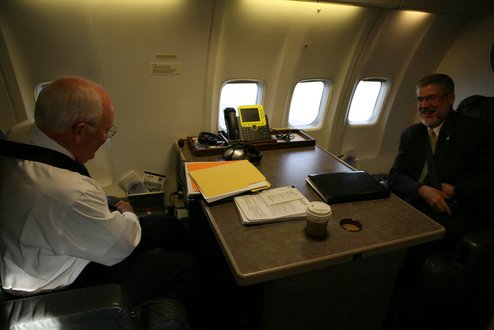 Vice President Cheney Talks with David Addington Aboard Air Force Two
