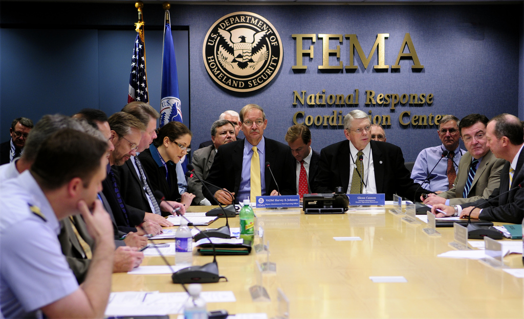 Washington, DC, August 28, 2008 --  FEMA Deputy Administrator, Harvey E. Johnson, Jr. (L- yellow tie) and FEMA Assistant Administrator/Disaster Operations Directorate, Glenn Cannon, chair a national Video Teleconference (VTC) with local, state and federal partners updating possible response/recovery actions to the projected impact area of Hurricane Gustav and Tropical Storm Hannah. The VTC takes place daily at the National Response Coordination Center (NRCC) within FEMA Headquarters.  Barry Bahler/FEMA