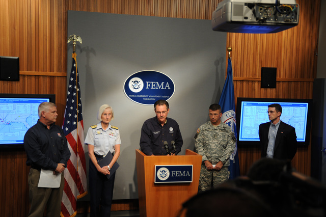 [Hurricane Gustav] Washington, DC, August 31, 2008 -- FEMA Administrator Paulison (podium) speaks to the press in the FEMA Press Briefing Room.  With him on the stage are, l - r: USCG Ed Hecker, United States Army Corps of Engineers, Rear Admiral Sally Brice-O'Hara, Deputy Commandant for Operations, Major General Richard J Rowe, Jr, United States Northern Command and Kevin Kolevar, Office of Electricity Delivery and Energy Reliability, DOE.  FEMA/Bill Koplitz