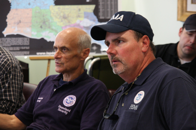 [Hurricane Gustav] Houma, LA, September 2, 2008 -- Michael Chertoff Secretary of Department of Homeland Security and Bill Ellis, Preparedness Analysis & Planning Officer FEMA, discuss with the Parish president Michel Claudet about the damages in Houma. Jacinta Quesada/FEMA