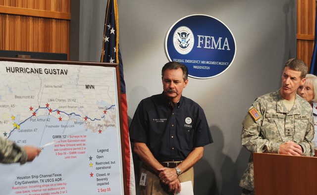 [Hurricane Gustav] Washington, DC, September 2, 2008 -- FEMA Administrator Paulison listens to the Major General Don T. Riley, US Army Corps of Engineers present the conditions in New Orleans and Louisiana after the passing of Hurricane Gustav.  Mr. Paulison (C), at podium Major Gen Don T. Riley, Deputy Commanding General, USACE, to his right RADM Sally  Brice-O'Hara, Deputy Commandant for Operations, USCG.  FEMA/Bill Koplitz
