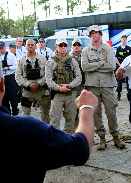 [Hurricane Gustav] Houma, LA, September 4, 2008 --  Members of the Customs and Border Protection Boarstar Unit out of  Tucson, receive their briefing as they prepare to assist the US& R Tennessee Task Force 1, and FEMA Urban Search and Rescue Teams following Hurricane Gustav.  Barry Bahler/FEMA