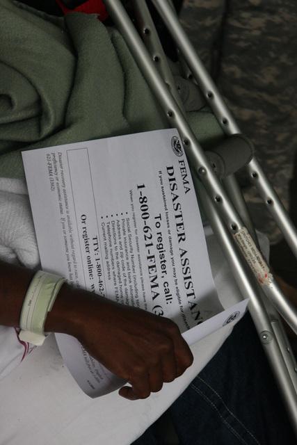 [Hurricane Gustav] New Orleans, LA, September 6, 2008 -- Special needs Re-entree evacuee holds a FEMA flier explaining how to register for aid. Jacinta Quesada/FEMA