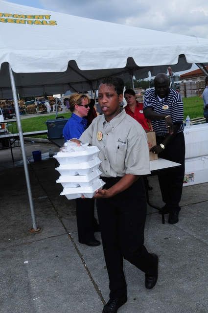 [Hurricane Gustav] Houma, LA, September 7, 2008 -- Annette Flyod, General Manager,Piccadilly's Restaurant- Baton Rouge, hands out hot meals.  The chain,  like many others in the region, provided Terrebone Parrish residents, a hot meal at  the Houma Civic Center. Power is still off in may parts of Louisiana, following Hurricane Gustav.  Barry Bahler/FEMA