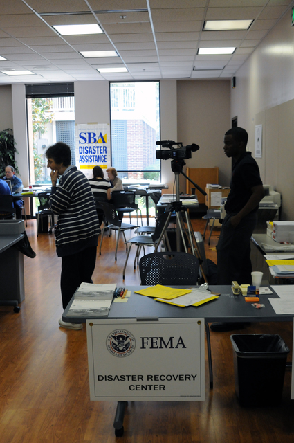 [Tropical Storm Fay] Tallahassee, FL, September 8, 2008 -- In the FEMA Leon County Disaster Recovery Center(DRC) a student reporter for a local college is filming for the school television station. FEMA is here due to flooding from Tropical Storm Fay.  George Armstrong/FEMA