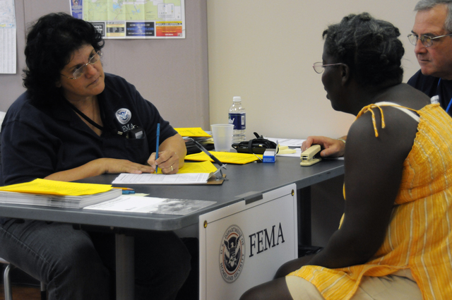 [Tropical Storm Fay] Tallahassee, FL, September 9, 2008 -- At the FEMA Leon County Disaster Recovery Center(DRC), FEMA Individual Assistance(IA) Specialist Rose Mary Sculthorpe assists this flood affected resident as State Emergency Response Team(SERT) Manager Randy Schreiber listens.  FEMA is here in response to Tropical Storm Fay.  George Armstrong/FEMA