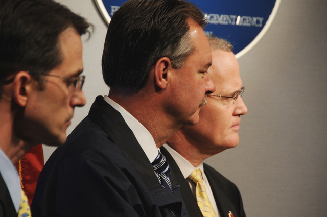 [Hurricane Ike] Washington, DC, September 12, 2008 -- l-r Kevin Kolevar, an assistant secretary from the Department of Energy, FEMA Administrator David Paulison and Joe Becker, senior vice president of disaster services for the American Red Cross listen at the Friday FEMA press briefing. Hurricane Ike was closing in on the Texas Gulf Coast. FEMA/Bill Koplitz