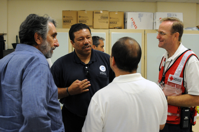 [Tropical Storm Fay] Estero, FL, September 13, 2008 -- At the Lee County Red Cross Shelter FEMA PIO William Lindsey speaks with Mexican Consulate Representative Brent L. Probinsky (left), Red Cross Shelter Manager Len Alvarez, and Consulate Protection Manager Edgardo Briones. FEMA is here tonight as honored guests of the Consulate in appreciation for services to residents displaced by flooding from Tropical Storm Fay. George Armstrong/FEMA