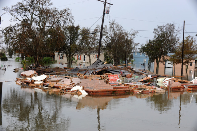 [Hurricane Ike] Sabine Pass, TX, September 14, 2008 -- Debris and water fill the streets following Hurricane Ike and this neighborhood remains flooded.  Jocelyn Augustino/FEMA