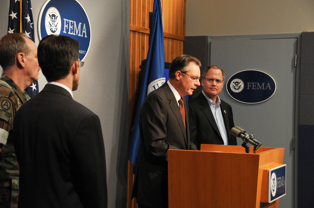 [Hurricane Ike] Washington, DC, September 15, 2008 -- FEMA Administrator Paulison at the podium reporting on recovery efforts for Texas and Louisiana following Hurricane Ike.  With him on the platform to his are l - r, Kevin Kolevar, Assistant Secretary for Electricity Delivery and Energy Reliability, Department of Energy (back to camera), Rear Admiral W. Craig Vanderwagen, Assistant Secretary for Preparedness and Response, U.S. Department of Health and Human Services (back to camera), (Mr. Paulison at podium),  Joe Becker, Senior Vice President of Disaster Services, American Red Cross.  FEMA/Bill Koplitz