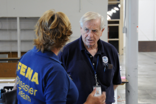 [Tropical Storm Fay] Ft. Pierce, FL, September 15, 2008 -- At the St. Lucie County FEMA/State Disaster Recovery Center(DRC), FEMA DRC Manager Tom Giddings speaks with FEMA PIO Renee Bafalis. FEMA is here in response to Tropical Storm Fay.  George Armstrong/FEMA