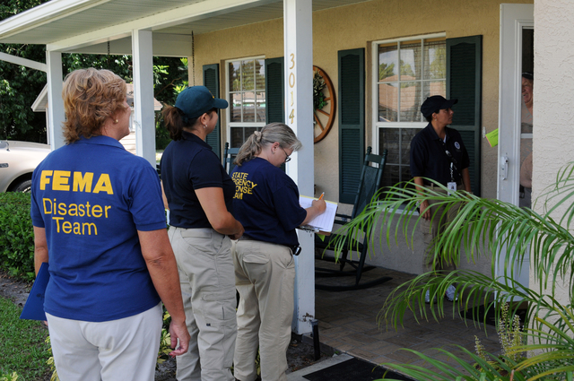 [Tropical Storm Fay] Ft. Pierce, FL, September 16, 2008 -- FEMA Community Relations(CR) Specialist Annette Moreno-Robinson, Community Emergency Response Team(CERT) member Josephine Brown, State Emergency Response Team(SERT) member Ann Farrior, and FEMA Public Information Officer(PIO) Renee Bafalis are providing door to door outreach for potential Tropical Storm Fay affected residents. George Armstrong/FEMA