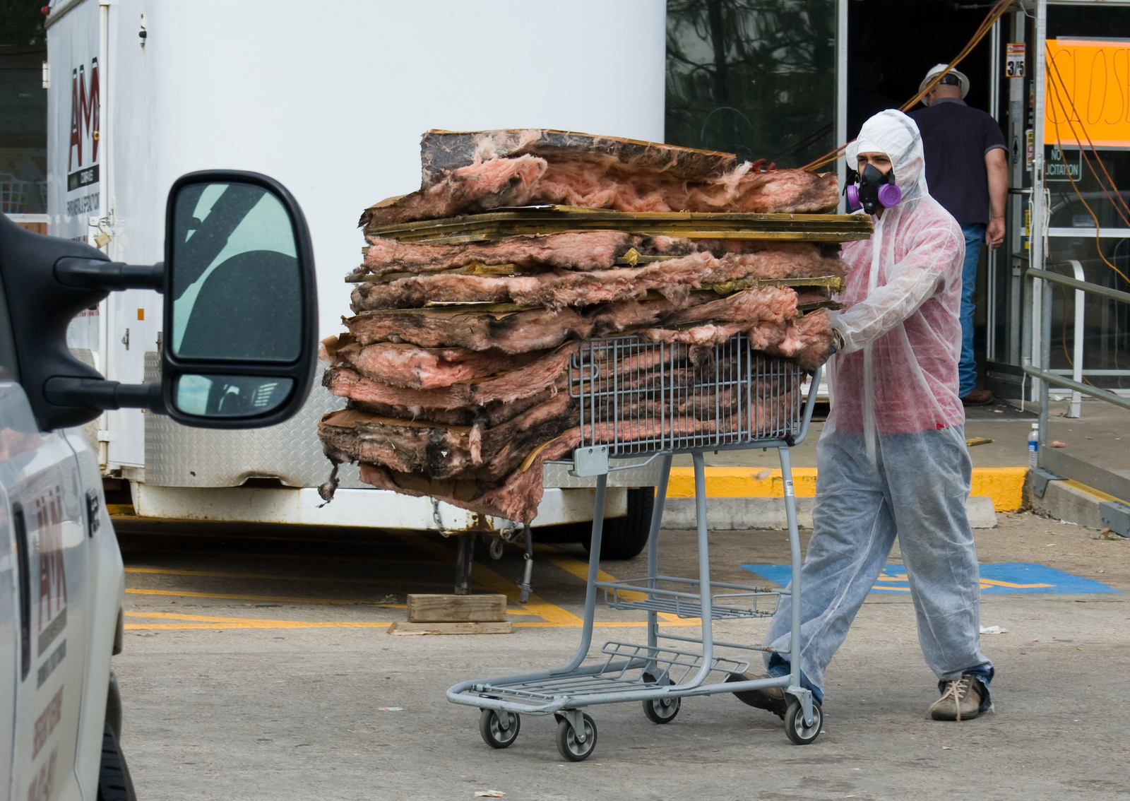 Hurricane/Tropical Storm - Winnie, Texas, September 18, 2008 -- A Hazmat team removes insulation from a neighborhood grocery store that suffered heavy flood damage during Hurricane Ike.  The storm caused severe damage all along the southeast Texas coast when it came ashore on September 13th.