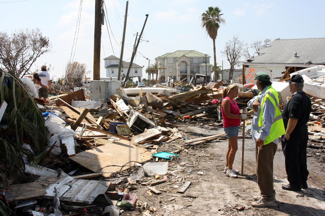 [Hurricane Ike] Galveston, Texas, September 21, 2008 -- Residents of Galveston Island sift through the rubble that once was their home prior to Hurricane Ike's arrival. Many streets are impassable due to debris which has made it unsafe for the general population to return. Robert Kaufmann/FEMA