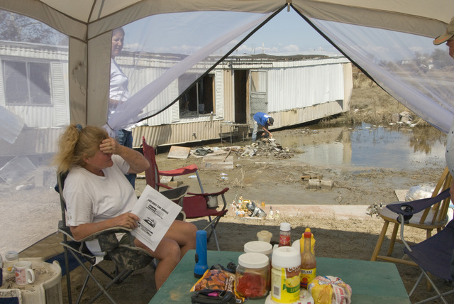 [Hurricane Ike] Sabine Pass,  TX, September 22, 2008 -- These people are living in a tent on their property because their home in uninhabitable in the wake of hurricane Ike. Photo by: Liz Roll/FEMA