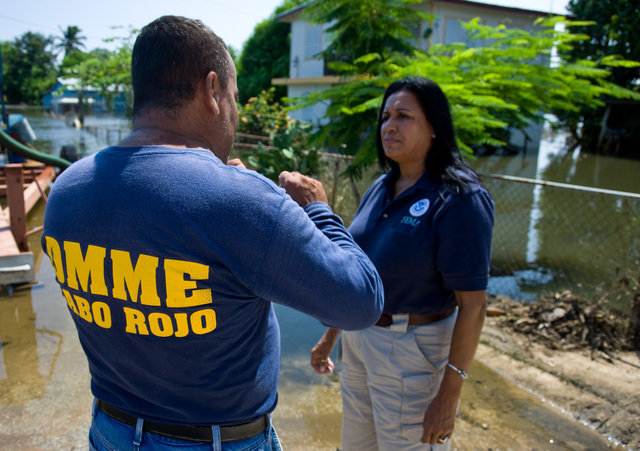 Mudslide/Landslide ^ Severe Storm - Cabo Rojo, Puerto Rico, October 1, 2008 -- FEMA Community Relations representative, Linda Colon talks with Cabo Rojo Emergency Manager, Herbert Rodriguez  about disaster recovery in flooded neighborhood. Andrea Booher/FEMA