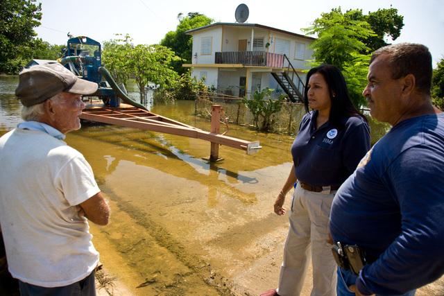 Severe Storm - Cabo Rojo, Puerto Rico, October 1, 2008 -- FEMA Community Relations representative, Linda Colon and Cabo Rojo Emergency Manager, Herbert Rodriguez  listen to resident in flooded neighborhood. Andrea Booher/FEMA