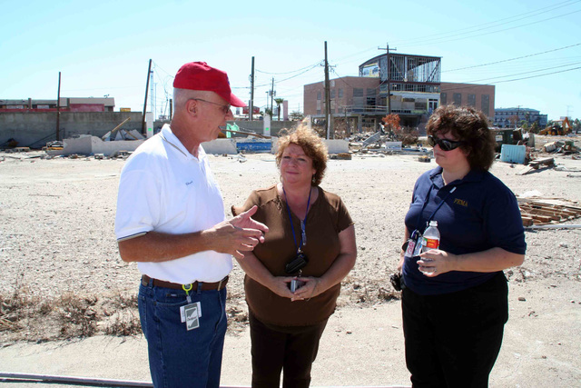 Hurricane/Tropical Storm - Seabrook, Texas, October 2, 2008 --  Seabrook City Manager Chuck Pinto describes the damage caused by Hurricane Ike's storm surge to FEMA DRC Manager Barbara Edwards and FEMA PIO Suzanne Novak.  All of the restaurants along the water were damaged; some were totally washed away.  Photo by Greg Henshall / FEMA