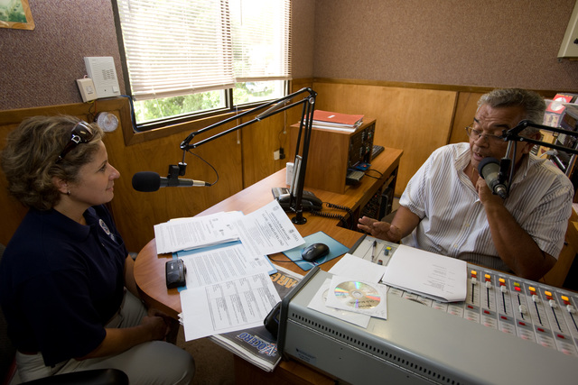 Severe Storm - Patillas, Puerto Rico, October 3, 2008 -- FEMA Representative, Carmen Rodriguez  delivers disaster information on air at local radio station in Patillas following the recent flooding in Puerto Rico. Andrea Booher/FEMA