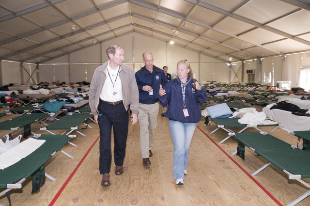 Hurricane/Tropical Storm - Galveston Island, Texas, October 28, 2008 -- Deputy Administrator Harvey Johnson tours a base camp for FEMA employees with Angela Cook, the FEMA shelter manager and Gerry Stoller, Branch director for the Galveston area.  Johnson was in the area to meet with local and federal officials to discuss on-going relief efforts in the aftermath of Hurricane Ike.  Photo by Patsy Lynch/FEMA