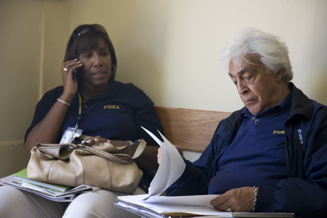 Severe Storm - Arroyo, Puerto Rico, October 28, 2008 -- FEMA Congressional Affairs representative, Nestor Llamas and Public Information officer, Maria Davila meet with the Arroyo Mayor, Basilio Figueroa to Jesus to discuss recovery efforts following the recent flooding in Puerto Rico. Andrea Booher/FEMA