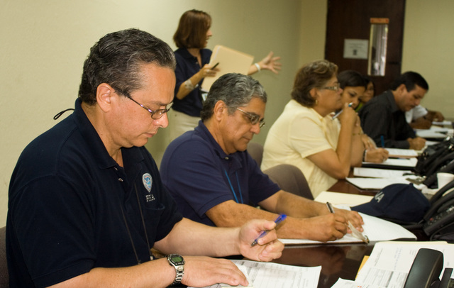 Flooding - Humacao, Puerto Rico, October 29, 2008 --  Community Relation's Edwin Class and Jose Vidal take notes during presentation given by Public Information Officer, Maria Malave.  FEMA officials met with Common Wealth emergency officials and with directors and coordinators from local organizations to discuss recovery efforts on the recent floods that affected the island. Ashley Andujar/FEMA