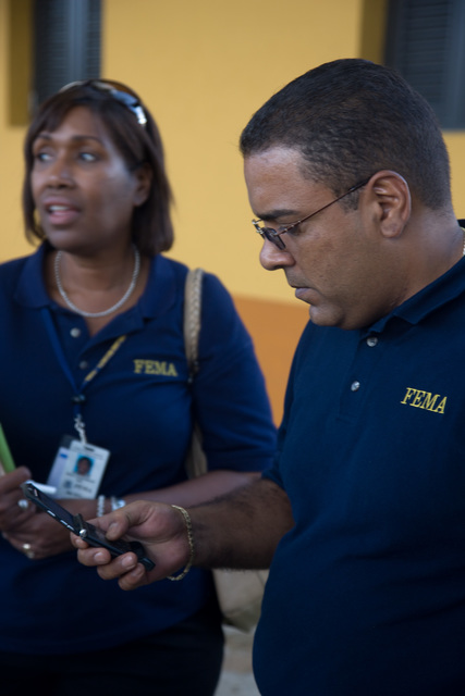 Flooding ^ Severe Storm - Juncos, Puerto Rico, November 1, 2008 -- FEMA Federal Coordinating Officer, Justo Hernandez and Public Information Officer, Maria Davila meet with the Juncos Mayor, Alfredo Alejandro Carrion to discuss recovery efforts following the recent flooding in Puerto Rico. Andrea Booher/FEMA