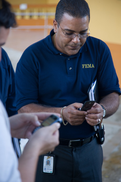 Severe Storm - Juncos, Puerto Rico, November 1, 2008 -- FEMA Federal Coordinating Officer, Justo Hernandez and Puerto Rico GAR, Jose Pineiro  prepare to meet with the Juncos Mayor, Alfredo Alejandro Carrion to discuss recovery efforts following the recent flooding in Puerto Rico. Andrea Booher/FEMA