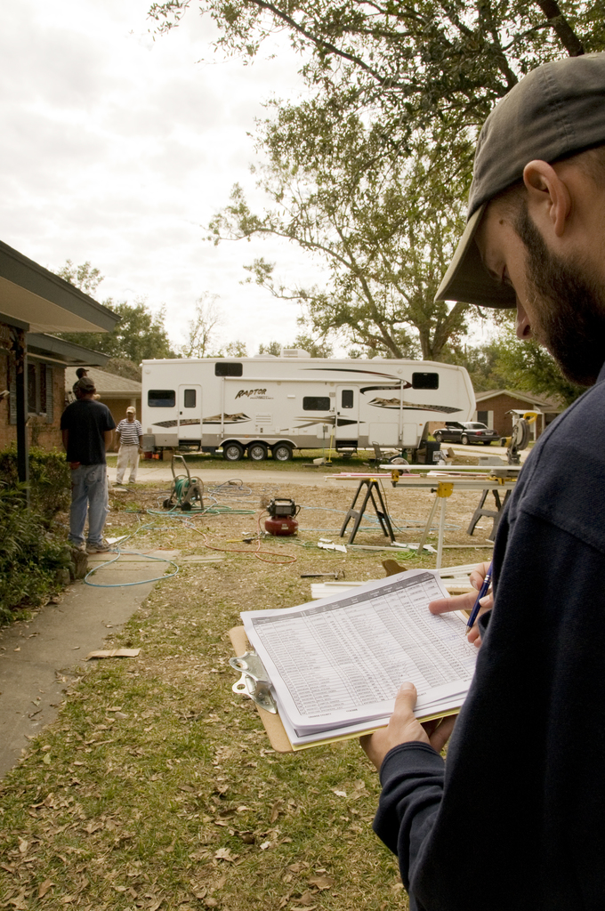 Hurricane/Tropical Storm - Bridge City, Texas, November 5,2008 -- Ben Juday, a member of the FEMA housing strike force, checks for the address of a home in Bridge City, TX.  FEMA has created this strike force to identify and contact those applicants who may still be in need of housing.  Photo by Patsy Lynch/FEMA