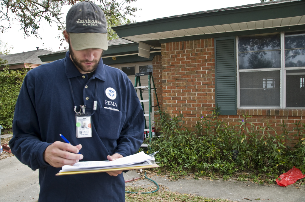 Hurricane/Tropical Storm - Bridge City, Texas, November 5,2008 -- Ben Juday, a member of the FEMA housing strike force, checks the address of a home in Bridge City, TX.  FEMA has created this strike force to identify and contact those applicants who may still be in need of housing.  Photo by Patsy Lynch/FEMA