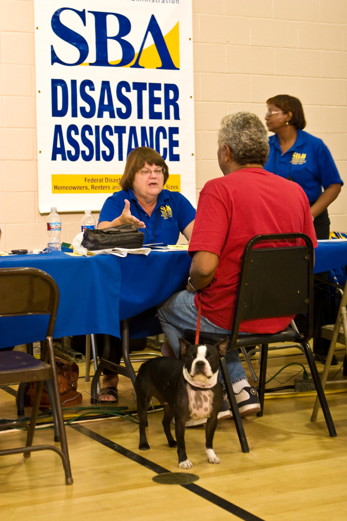 Fire ^ Wildfire - Sylmar, Calif. , November 20, 2008 -- A disaster victim and his pet speak to a disaster specialist from the Small Business Administration (SBA) at the Sylmar Local Assistance Center.  The SBA makes low interest disaster assistance loans available to residents who are impacted by declared disasters.