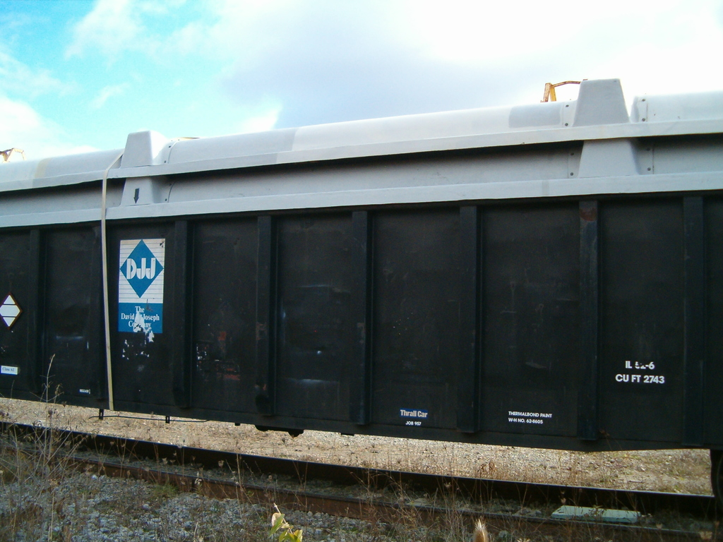 Incoming railcars with additional lids strapped on [Potential Release Site 441 - Railroad Yard]