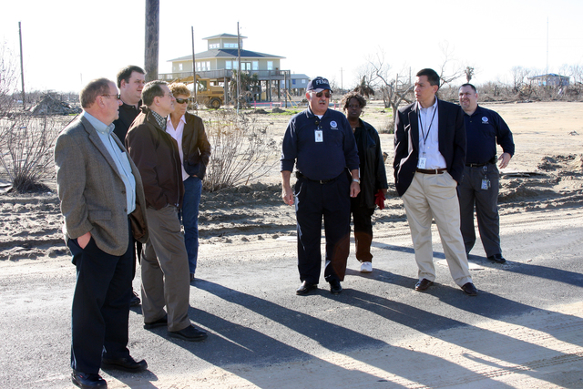 Hurricane/Tropical Storm - Bolivar, Texas, January 12, 2009 -- A group consisting of (left to right) FEMA Region 6 Comptrollers Steve Gwilliam and Chris Riley, former Acting Chief Financial Officer Bruce Redcay and Finance/Admin Section Chief/Comptroller Ginger Plummer, with FEMA Liason to Galveston Terence McAdler in the center followed by, Deputy Chief Financial Officer Lorna McAlister, Chief Financial Officer Norman Dong and J. J. Jenkins, Comptroller Cadre Manager, stop along their tour of Bolivar, Texas to see first hand the damage created by Hurricane Ike. Robert Kaufmann/FEMA