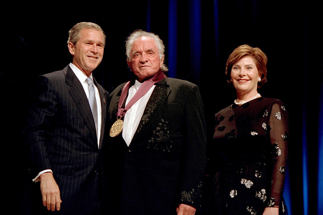 President George W. Bush and Mrs. Laura Bush with 2001 National Medal of Arts Recipient Johnny Cash