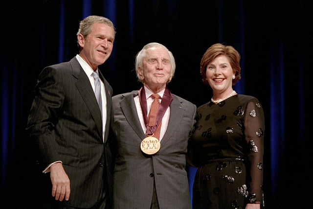 President George W. Bush and Mrs. Laura Bush with 2001 National Medal of Arts Recipient Kirk Douglas