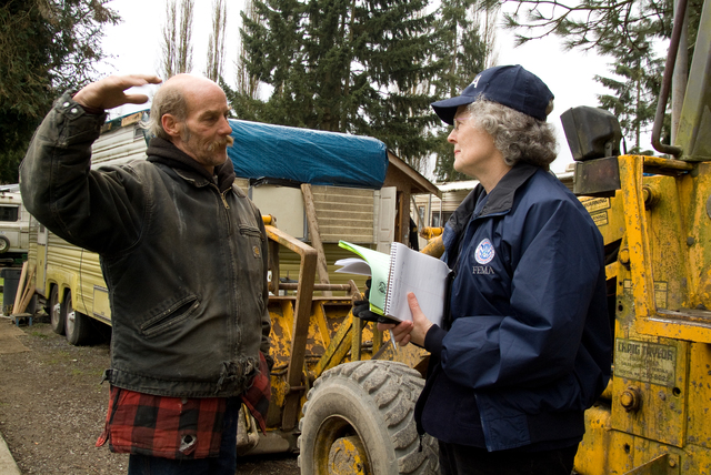 Flooding ^ Winter Storm - Snohomish, Wash. , February 7, 2009 -- FEMA Community Relations (CR) Specialist Martha Mills discusses registration options with a local resident in the Three Rivers Trailer Park. President Obama declared a federal disaster for Washington state in the wake of the severe winter storms. Adam DuBrowa/FEMA