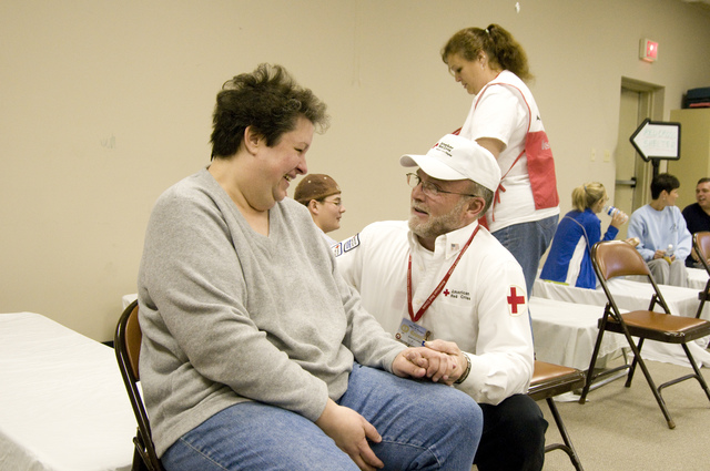 Winter Storm - Princeton, Ky. , February 21, 2009 -- At a Red Cross shelter, shelter manager Bill Carrington comforts Lynn Jones. The January 27th ice storm left thousands without power, many for two weeks or more. Photo by Liz Roll