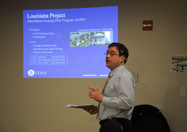 Washington, D. C. , February 25, 2009 -- Mikhael Schlossman presented the Alternative Housing Pilot Program (AHPP): 5 Projects, 4 States, $400 Million, to group of FEMA employees at a Brown Bag lunchtime discussion.  FEMA/Bill KoplitzThe AHPP is a one-time, four-year pilot to identify and evaluate better ways to house disaster victims. It resulted from a $400 million Congressional appropriation in 2006 and is identified as a key program in FEMA's National Disaster Housing Strategy. Designed as a grant program to address housing needs, five (5) of the 29 AHPP projects submitted were awarded to four (4) states. Project implementation is underway. FEMA/Bill Koplitz