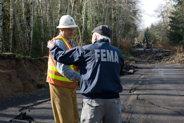 """Coastal Storm ^ Flooding - Sekiu, Wash. , March 2, 2009 -- FEMA Public Information Officer (PIO) Ernie Martz and WA DOT supervisor Bill """"Hallelujah"""" White shake hands and greet during a damage survey to State Route 112 along the Straight of Juan De Fuca. After severe flooding from recent storms damaged the highway DOT crews work tirelessly to repair roads and critical infrastructure.  Adam DuBrowa/FEMA"""
