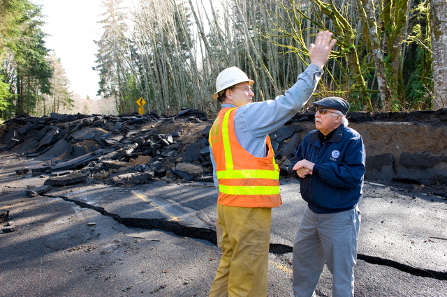 """Flooding - Sekiu, Wash. , March 2, 2009 -- Along The Strait of Juan De Fuca, FEMA Public Information Officer (PIO) Ernie Martz and WA DOT supervisor Bill """"Hallelujah"""" White discuss recent flood levels during a damage survey to State Route 112. After severe flooding damaged the highway, DOT crews work to repair critical infrastructures. Adam DuBrowa/FEMA"""